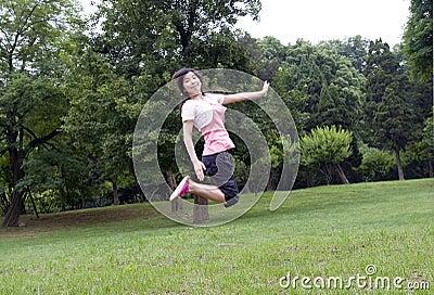 Asian girl jumps
