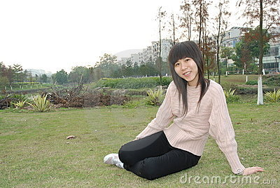 Asian girl on lawn