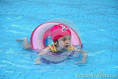 Asian girl learn to swim
