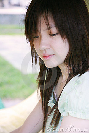 Free Asian Girl Looking Down Stock Photography - 3444882