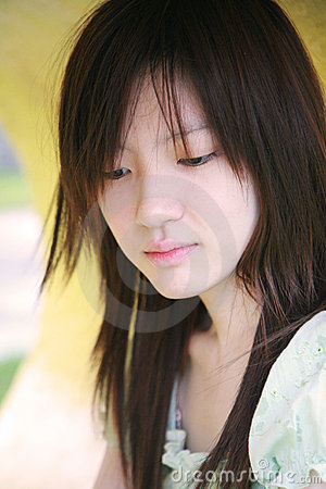Free Asian Girl Looking Down Stock Images - 3444894