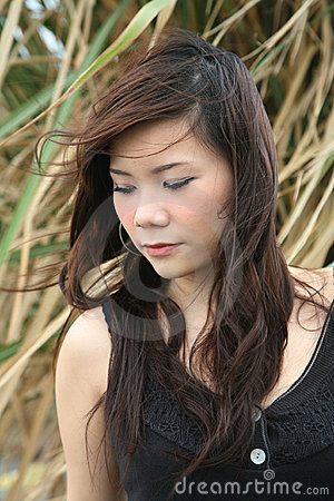 Free Asian Girl Looking To The Side Royalty Free Stock Photo - 2558855