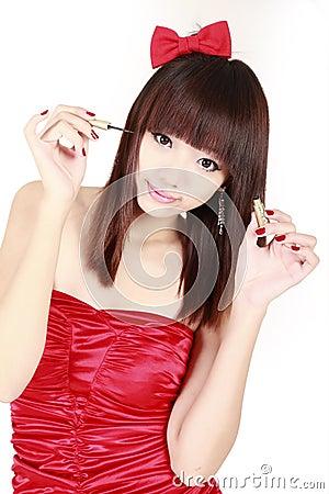 Free Asian Girl Making Up Stock Photos - 12246033