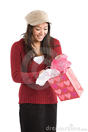 Asian girl opening valentine gift