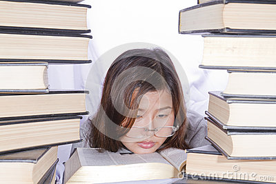 Asian girl in pile of books
