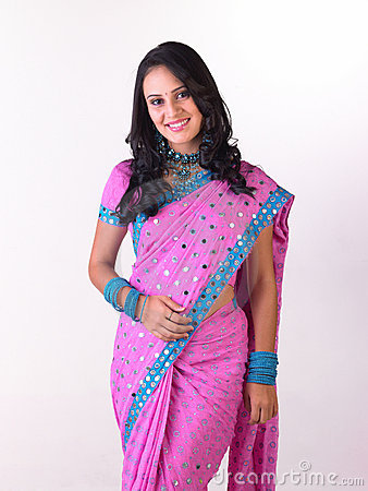`Asian girl in pink sari with rich jewelery