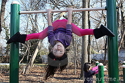Asian girl playing on bars