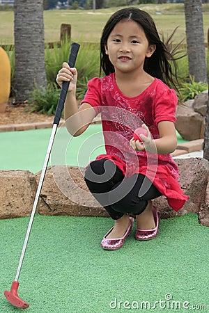 Free Asian Girl Playing Mini Golf Royalty Free Stock Photography - 17633857
