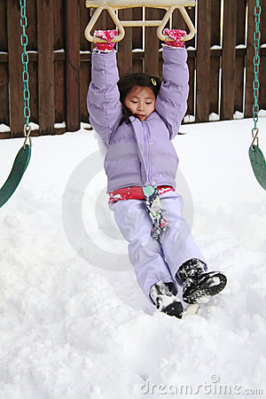 Asian girl playing in snow