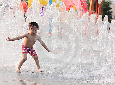 A asian girl playing by water fountain Editorial Stock Photo