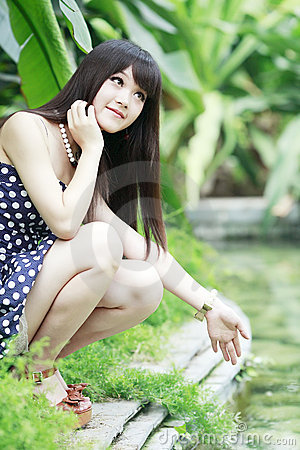 Asian girl in pond edge