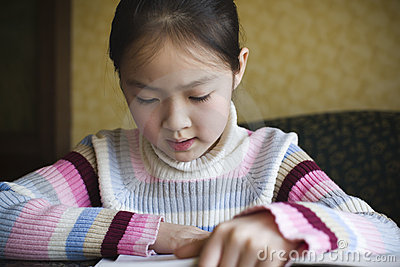 Asian girl reading a book