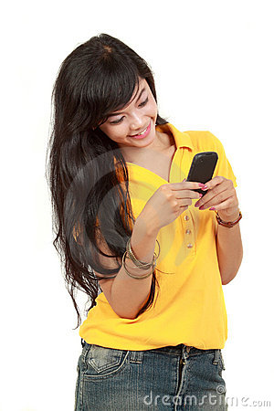 Asian girl receiving text message