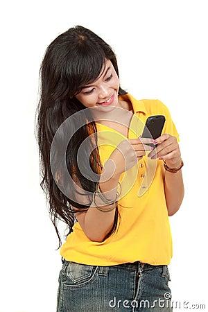 Asian girl receiving text message
