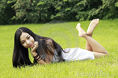 Asian girl relaxing outdoor.