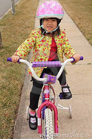 Asian Girl riding Bike