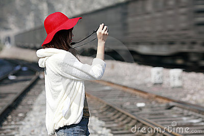 Asian girl shooting train