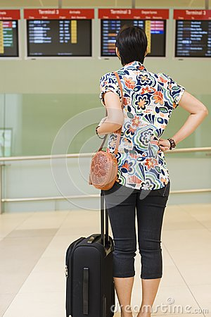 Asian girl at singapore s changi airport terminal