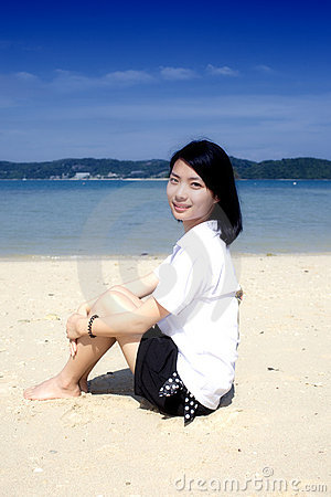 Asian girl sitting on the phuket beach