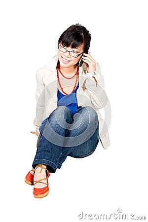 Asian girl speakin on cell phone