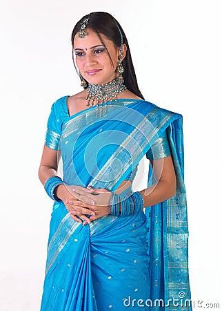 Asian girl standing in blue sari