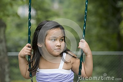 Asian girl in swing