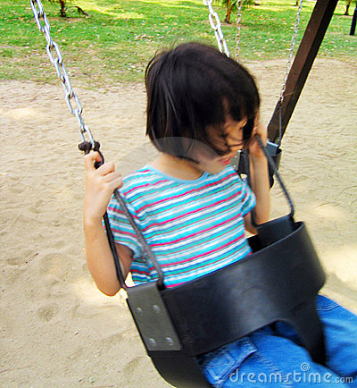 Asian girl on swing