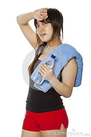Asian girl with towel and bottle of water
