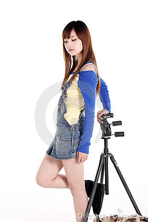 An Asian girl with the tripod