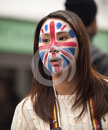 Asian girl with union flag painted on her face Editorial Stock Photo