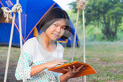 Asian girl using tablet