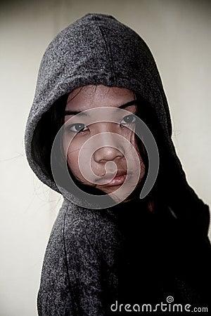 Asian girl wearing a hood