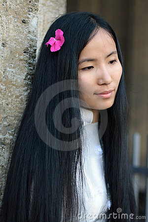 Free Asian Girl With Flower In Her Hairs Looking Down Stock Images - 10937444