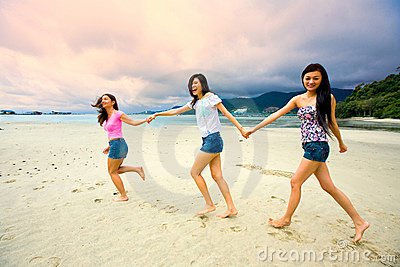 Asian girls have fun at the beach