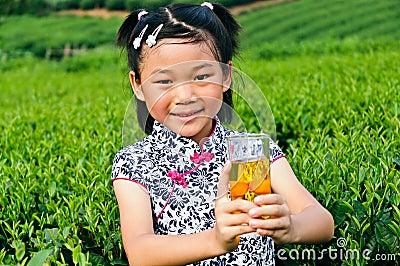 Asian girls show green tea