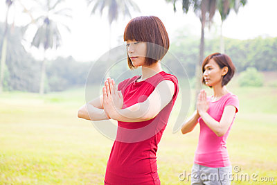 Asian girls yoga at outdoor