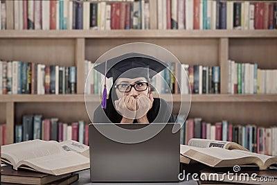 Asian graduate afraid of exam at library