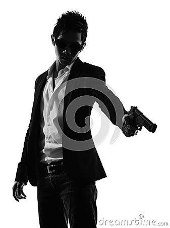 Asian gunman killer  portrait shooting silhouette