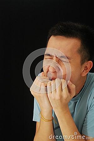 Asian guy cheeky laughing