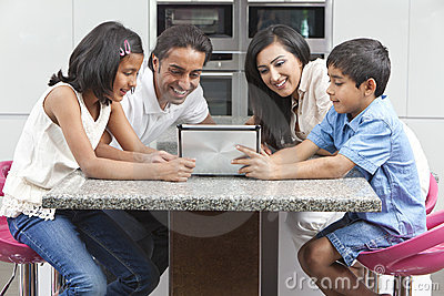 Asian Indian Family Using Tablet Computer at Home
