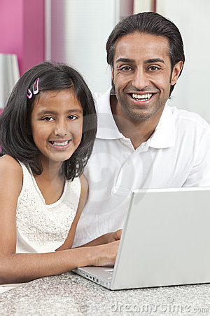 Asian Indian Father & Daughter Using Laptop