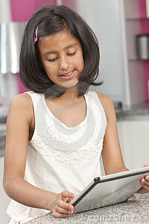 Asian Indian Girl Child Using Tablet Computer