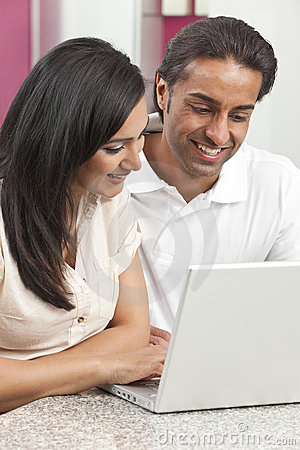 Asian Indian Man & Woman Couple Using Laptop