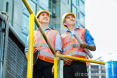 Asian Indonesian construction workers