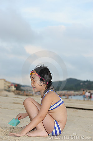 Asian kid on beach