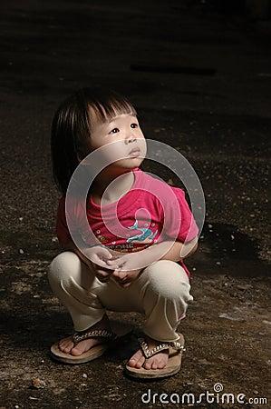 Asian kid in dark
