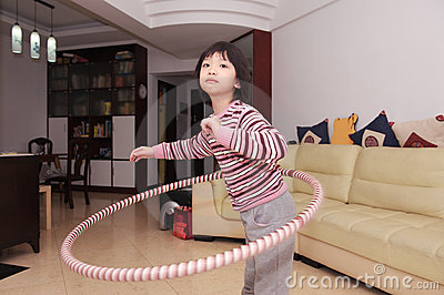 Asian kid hula hooping