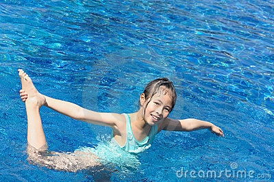 Asian kid playing in swimming pool