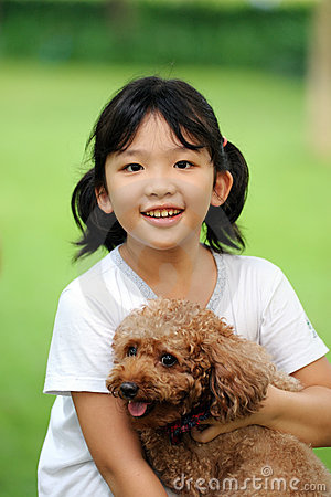Free Asian Kid Playing With Dog Stock Image - 21125331