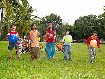 Asian kids playing in the park